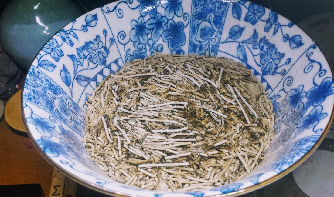 An offering bowl filled with incense.