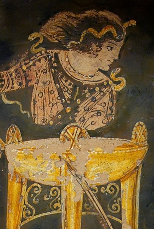 Pythia and tripod from a Greek vase. Wikimedia commons.