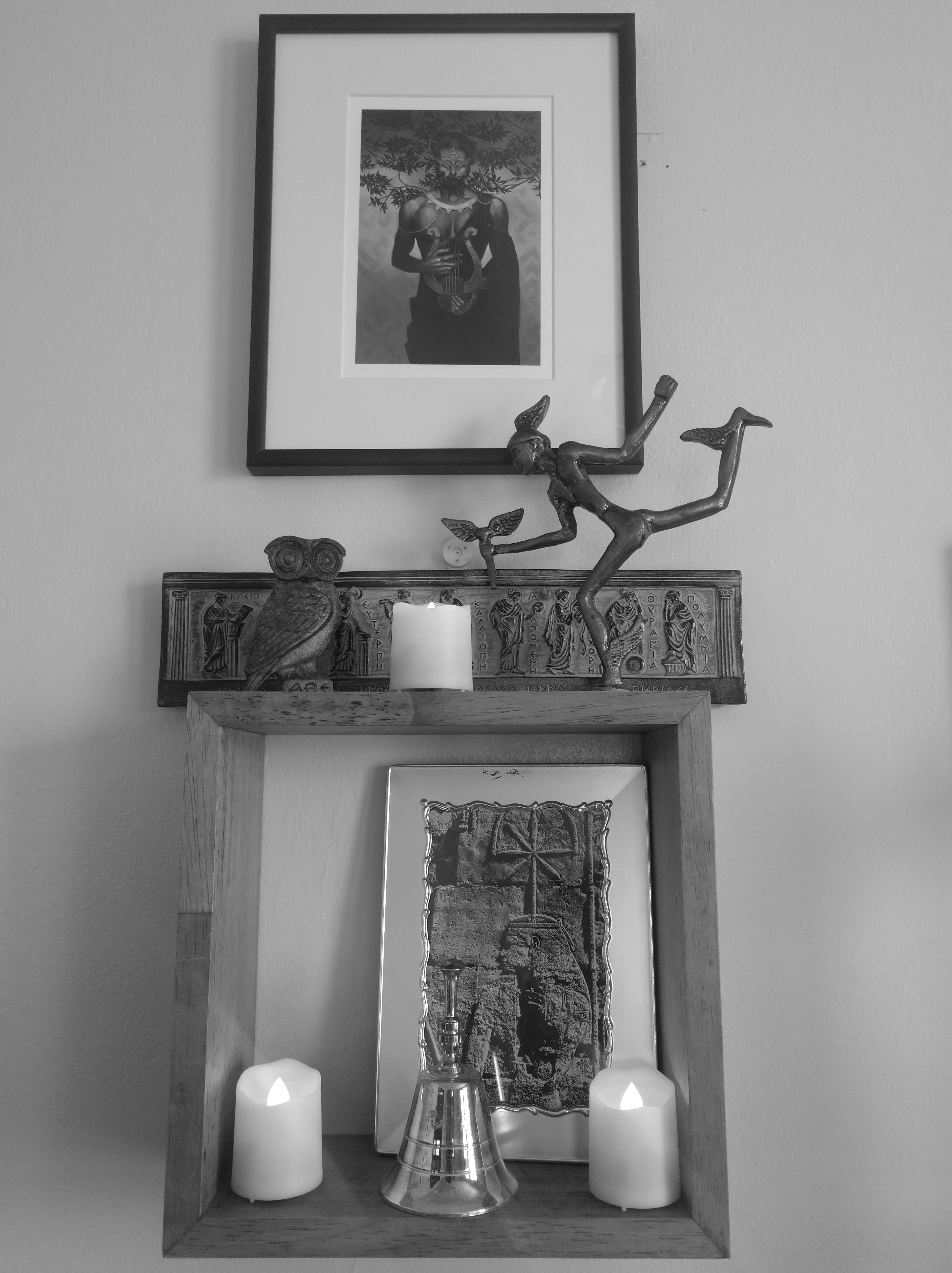 The same shrine in black and white with candles lit.
